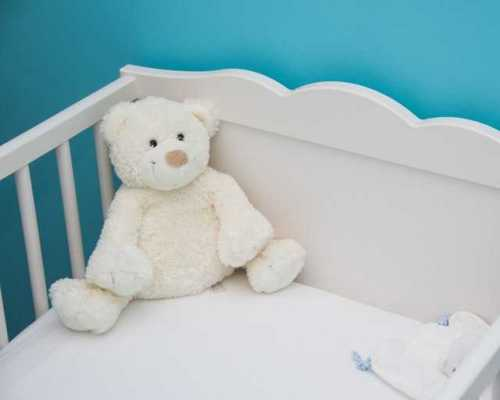 baby crib with a teddy in it