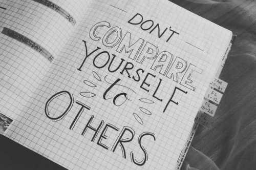 don't compare yourself written on a notebook page