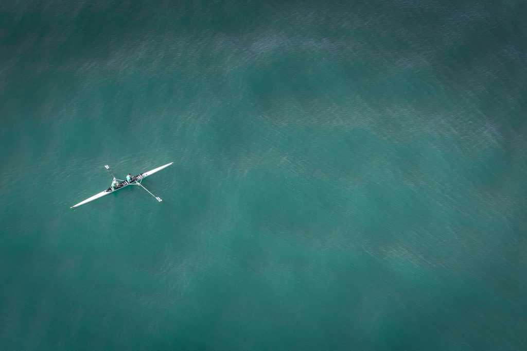 high up view of doubles scullers on a large body of water