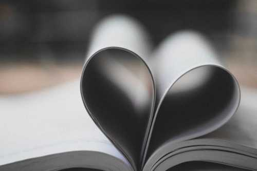 open book, with pages folded into the shape of a heart