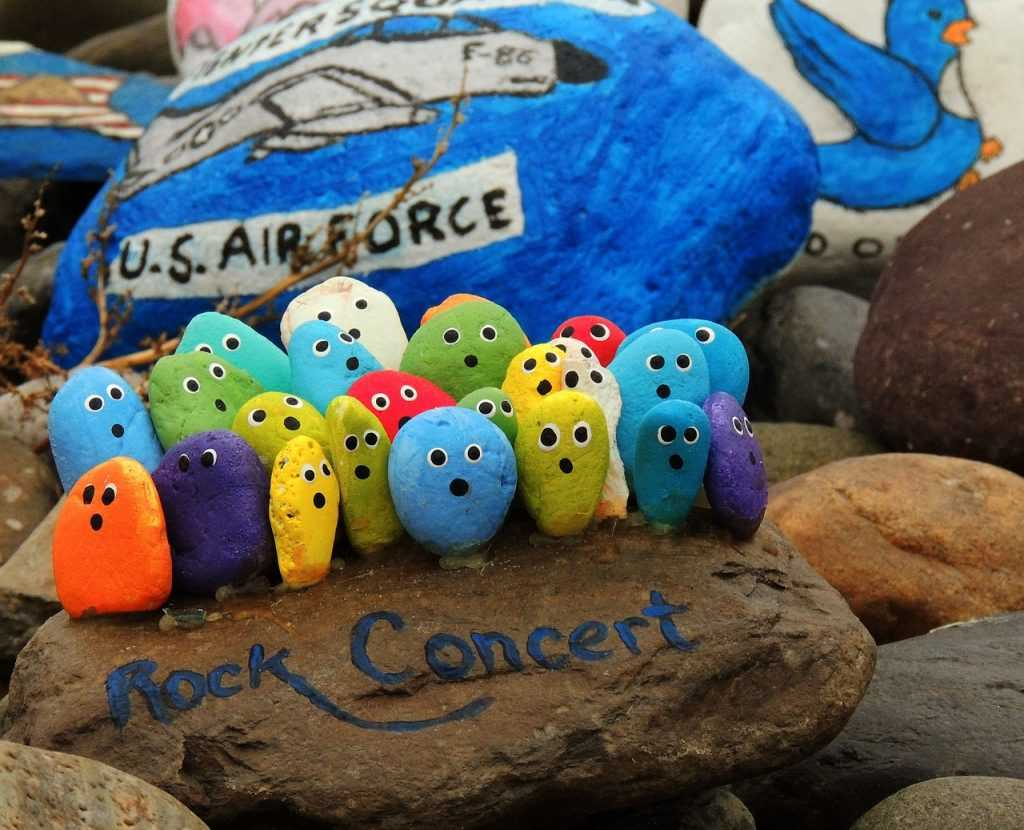 painted rocks in the shape of a concert